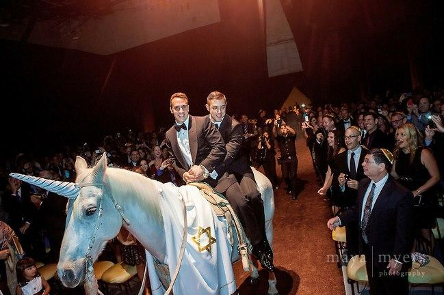 Internet goes wild over photo of two Jewish men riding a unicorn into their wedding